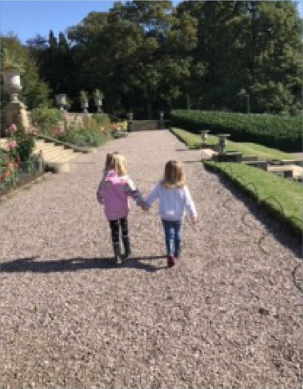 two young girls hand in hand